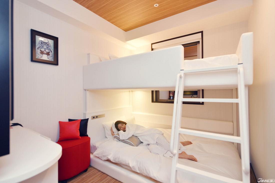 ① Chambre à lits superposés